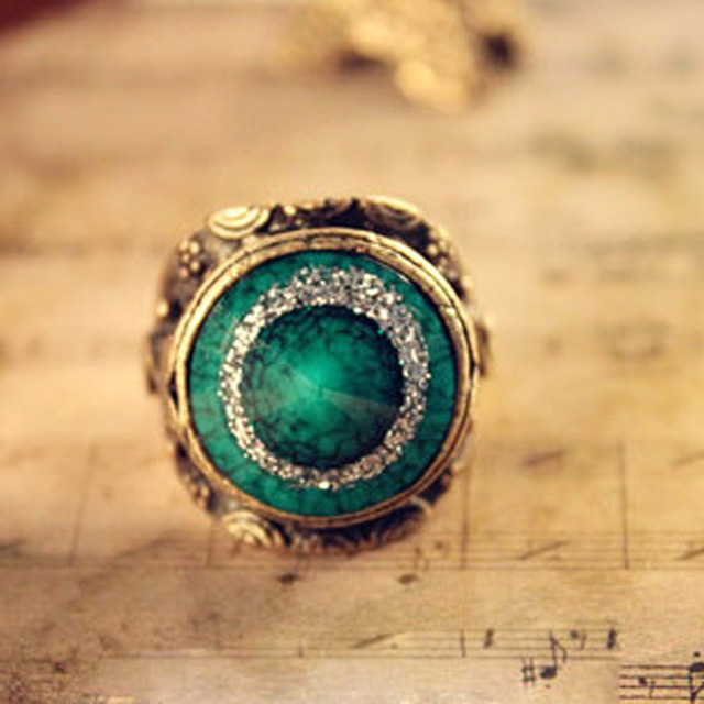 Turquoise ring of carve patterns or designs on woodwork restoring ancient ways