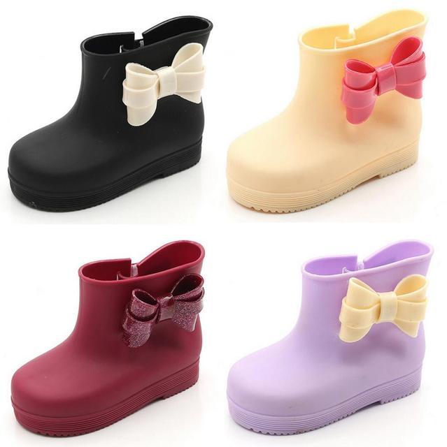 2016 Otoño Zapatos de La Jalea Arco Botas De Goma De Alta Zapatos Casuales Zapatos de Los Niños del bebé Botas de Lluvia Impermeables Niños y niñas Boost