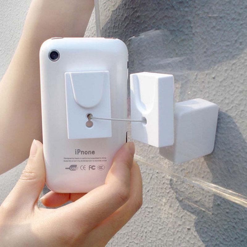 цены на 50 pcs mobile phone security stand handheld display holder wall desk mount anti theft retractable pull wire box for retail shop в интернет-магазинах
