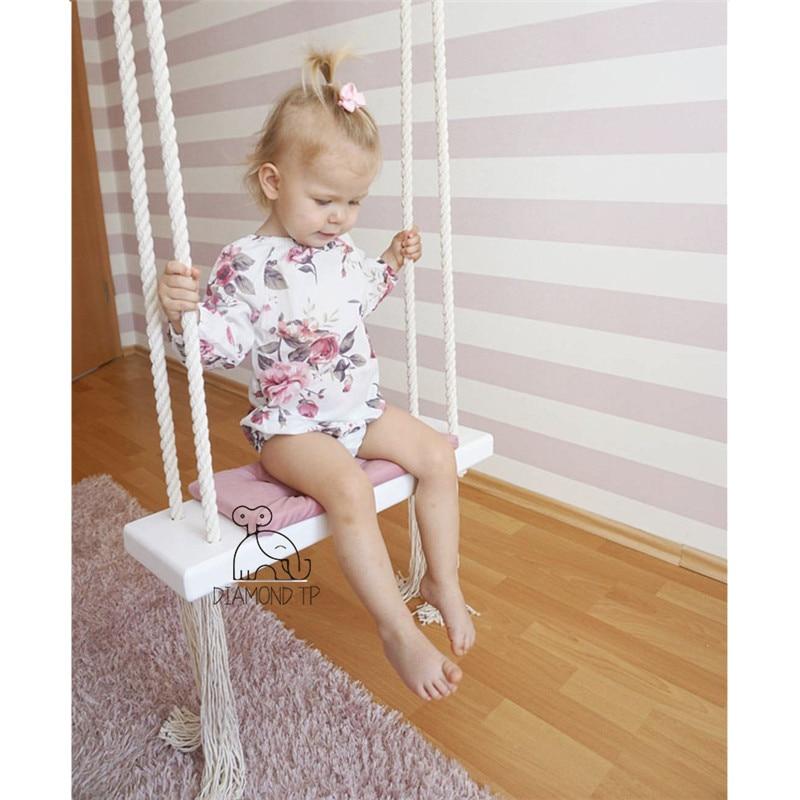 INS enfants balançoire chaise bébé divertissement balançoire en bois massif éponge Pad coton corde balançoire bébé accessoires pour la photographie enfant