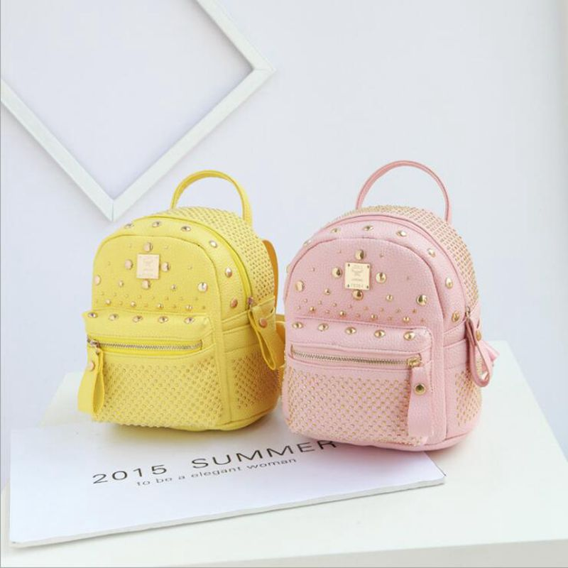 Free shipping 2017 new leisure rivet rucksack high quality women shopping package ladies preppy style backpack
