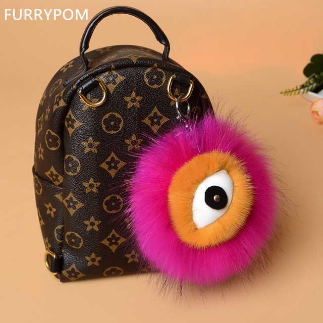2017 real fur ball keychain One-eyed Monster raccoon pompom round women  backpack bag pendant wholesale key chains e0f5afc39
