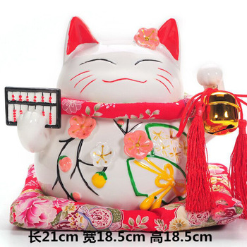 A large ceramic abacus red fan Lucky Cat money piggy bank ornaments shop opened decoration gifts