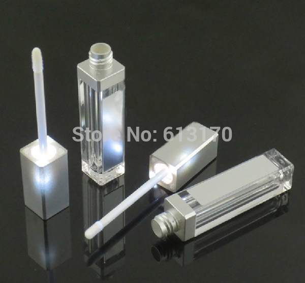 Free shipping 8ml lip gloss tubes with black silver cap and LED light DIY Empty mascara