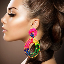 The new 2019 hollow-out lafite grass earrings handmade diy fashion lady stud earrings vintage hollow out pattern spiral stud earrings