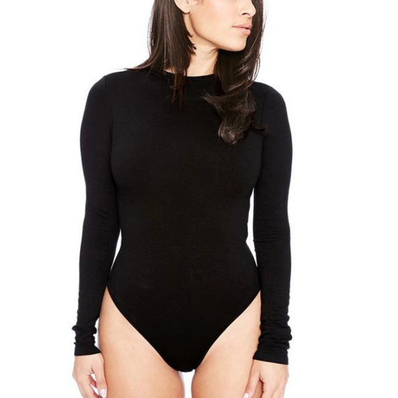 Johanna Ortiz Crewneck Long-Sleeve Bodysuit w/ Western Piping Details Johanna Ortiz bodysuit features a contrast floral-print bottom. Crew neckline. Long sleeves; button cuffs with Western piping. Three-button back closure. Cutout open back. Thong back minimizes panty line. Polyester/rayon/spandex. Lining, viscose/spandex. Dry clean. Made in Colombia.