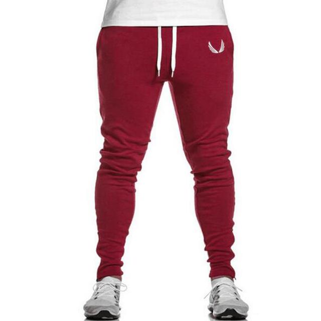 Venda quente dos homens calça casual Slim Fit calças confortáveis homens moda Sweatpants Corredores Calças selvagens calças colapso