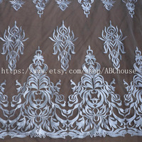 High end elegant fine workmanship tulle mesh embroidered wedding lace fabric with cording bridal gown lace 130cm by yard