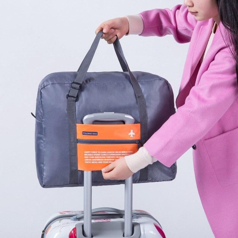 OKOKC-Fashion-WaterProof-Travel-Bag-Large-Capacity-Bag-Women-Oxford-Folding-Bag-Unisex-Luggage-Travel-Handbags (2)