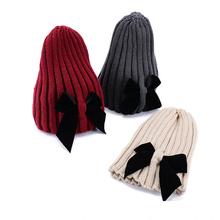 ca4207d0b04b6 1pcs Winter Knitted Hats For Female Fashion Leisure Bow Caps Solid Color  Black Gray Red Beanies