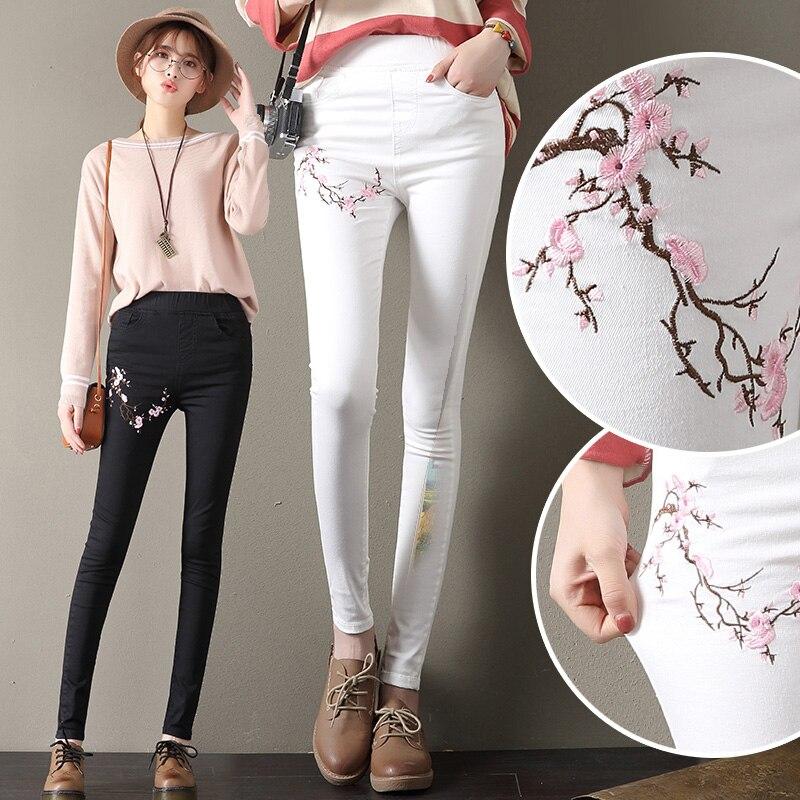 High Waist Jeans Women 2017 Autumn New Slim Peach Floral Embroidery Denim Pencil Pants Casual Black White Elastic Woman Trouers