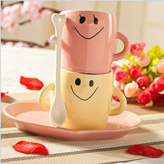 cute couple shaking hands with ceramic cups smiling face couple