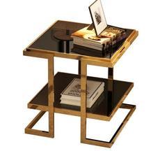 Simple modern sofa corner. Metal tempered glass multi-layer white edge table. Small tea table..