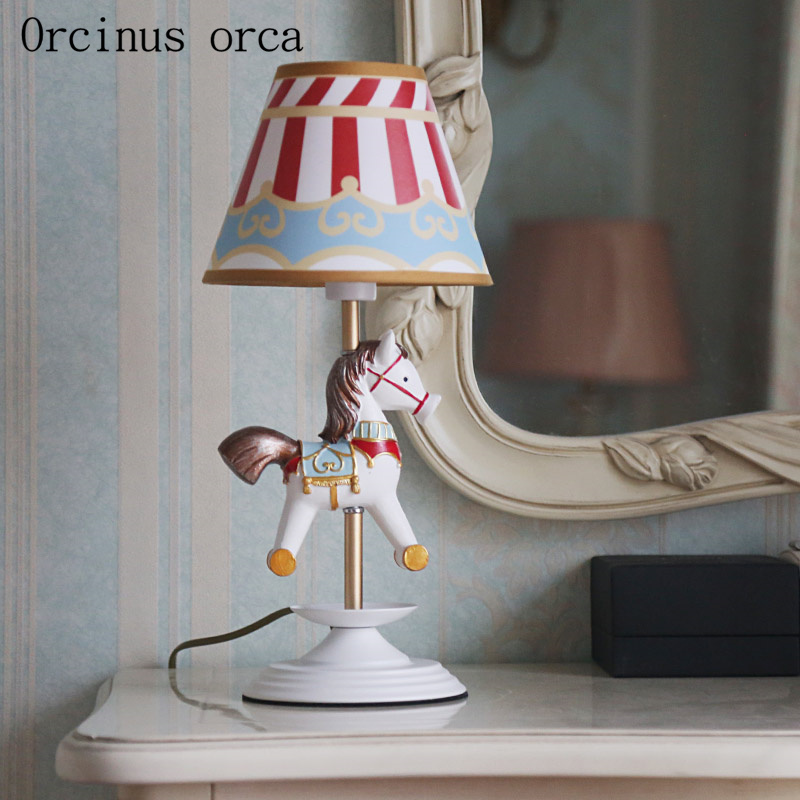 Cartoon creative merry go round desk lamp Boy Girl Bedroom bedside lamp American personality LED animal resin desk lamp