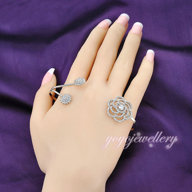 Mytys White Gold Plated Open Cuffs Adjustable Size Flower Crystal Palm Bangle Fashion Palm Bracelet Handlet R941