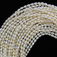 Free Shipping Wholesale 10pcs New 6 7mm White Freshwater Pearl Rice Beads 14 Strand