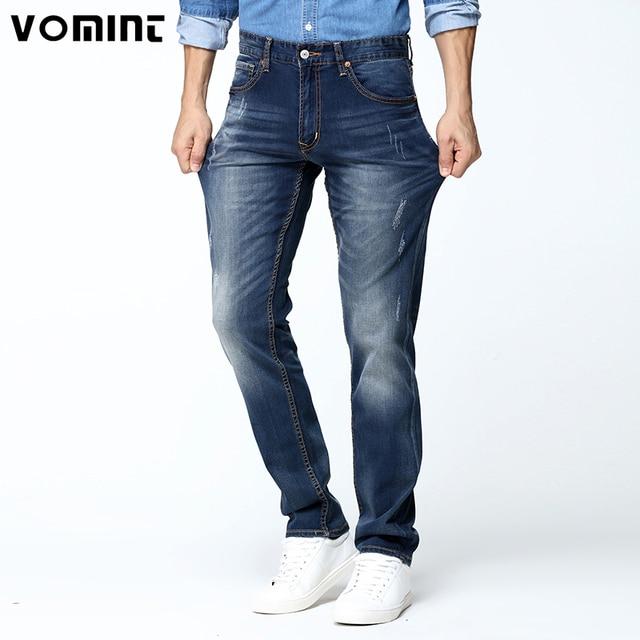 d6bf14f5261b0 2017 Nueva Verano hombres Jeans Regular Fit pantalones Casuales Elástico  Jean Tela Lavada Denim Sólido Pantalones