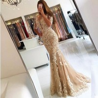 2017 New Elegant Champagne Lace Tulle Mermaid Prom Dresses Half Sleeves Sexy Backless Illusion Sheer Scoop