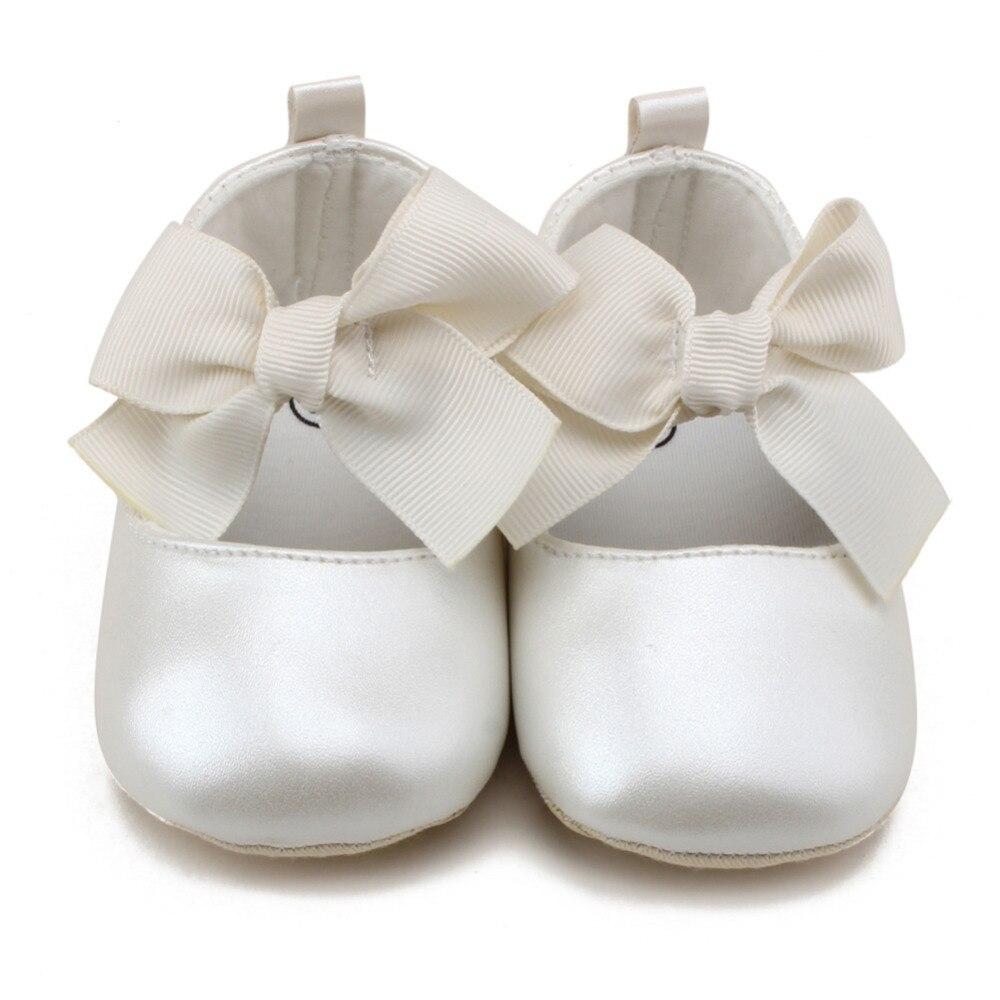 בייבי קיד ילדה נסיכת נעליים מזדמנים PU דירות רכות נעליים ראשון הליכונים נעלי תינוק קשת לבן