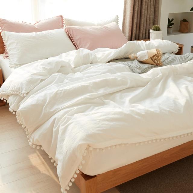 4c62f1b64633 white bedding set, 100% washed cotton, bedlinen pom pom ribbon details,  Magical Thinking Pom-Fringe Duvet Cover
