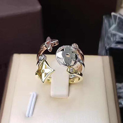 Hot Brand stainless steel three colored three piece ring between the hollow four leaf flowers golden four leaf open ring