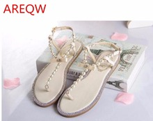 AREQW 2016 bow women's flip-flop shoes rc t flip flops rhinestone pearl sandals female flat women's shoes size 33–43