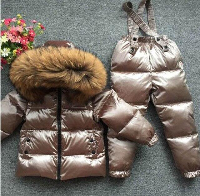 子供の少年少女子供の赤ちゃんの余分な厚いダウンジャケットはフルの動物の毛の襟のスキースーツトップとズボン