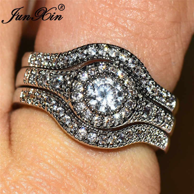 JUNXIN สตรี Triple แหวนชุดสีขาว 925 เงินซ้อนทับสีขาว CZ หมั้นแหวนคู่ Wave แหวนของขวัญ