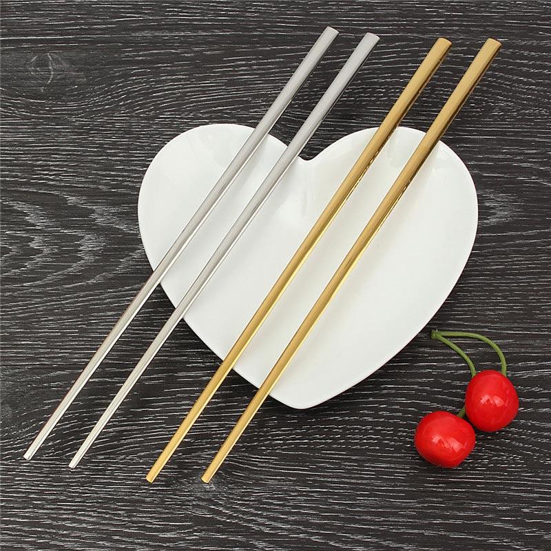 Новинка! 1 пара Титан позолота Палочки китайские китайский многоразовые Нержавеющаясталь металла нарезать stick Хаши Посуда для подарков