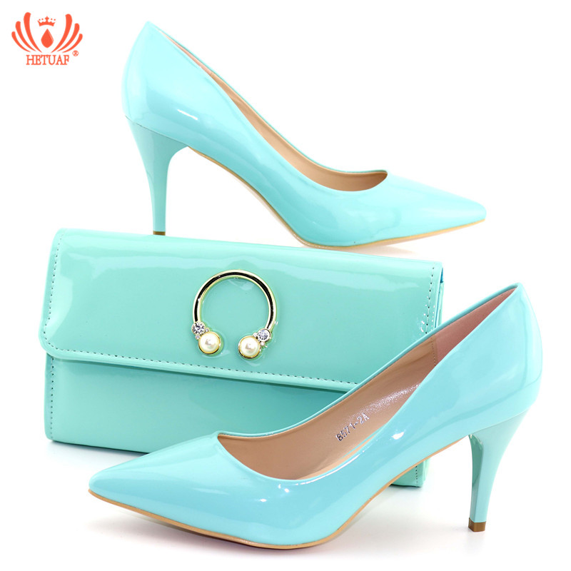 fa8c512ff5e frica-zapatos-y-bolso-de-fiesta -azul-cielo-dise-o-personalizado-juego-italiano-Oficina-dama.jpg