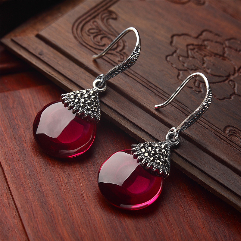 Long Baolong 925 sterling silver jewelry earrings white corundum red eye spring Ms. new special offer
