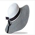 2016 New Fashion panama Black White Striped Bowknot Summer sun Hat Women Beautiful Beach Straw Hat hat brimmed hat