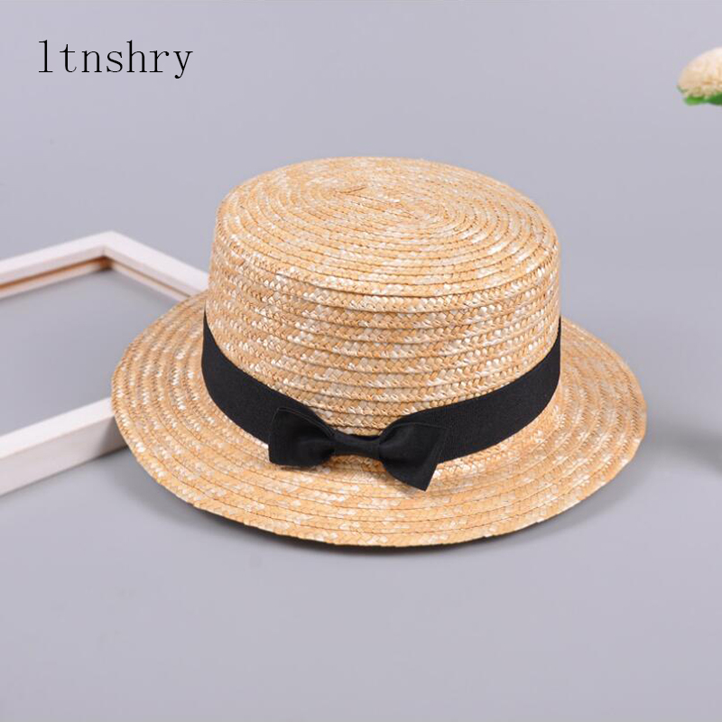 Cute Child Girls Straw hat Bowknot Sun Hat Kids Large Brim Beach Summer  Boater Beach Ribbon Round Flat Top fedora hat 54CM-in Hats   Caps from  Mother   Kids ... 7551e8aa2c7c