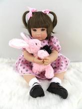 Muñeca reborn de 50 cm con vestido  rosa a lunares