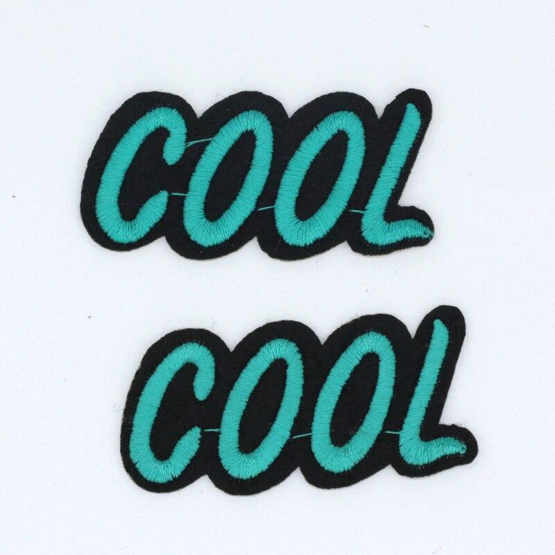 10 pçs lote NOVO 60 30mm Azul LEGAL do logotipo do Projeto Iron On Bordados  Remendo De Pano Emblema Dos Desenhos Animados Vestuário apliques DIY  Acessório 761e4d63f6d