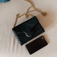 Luxury brand wallet with chain