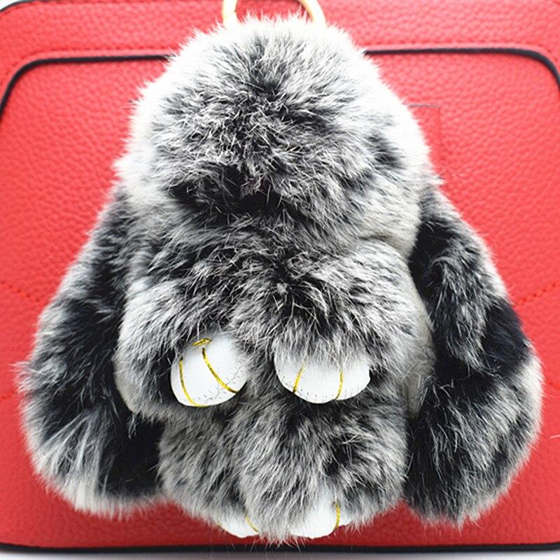купить 2017 new trinket pompom keychain bunny keychains on bag rabbit fur Keychain fur pom pom charms for bags anime по цене 308.71 рублей
