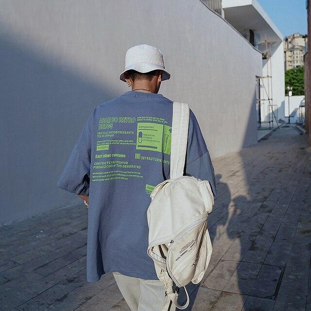 Manvalue masculina manga curta topos oversize solto efeito o-pescoço camisetas letras impressas manga curta japonês retro t-shirts