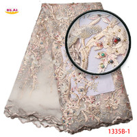 latest african tulle lace fabric 2017 high quality lace diamond and beaded lace fabric embroidery lace trim for weddingNA1335B-1
