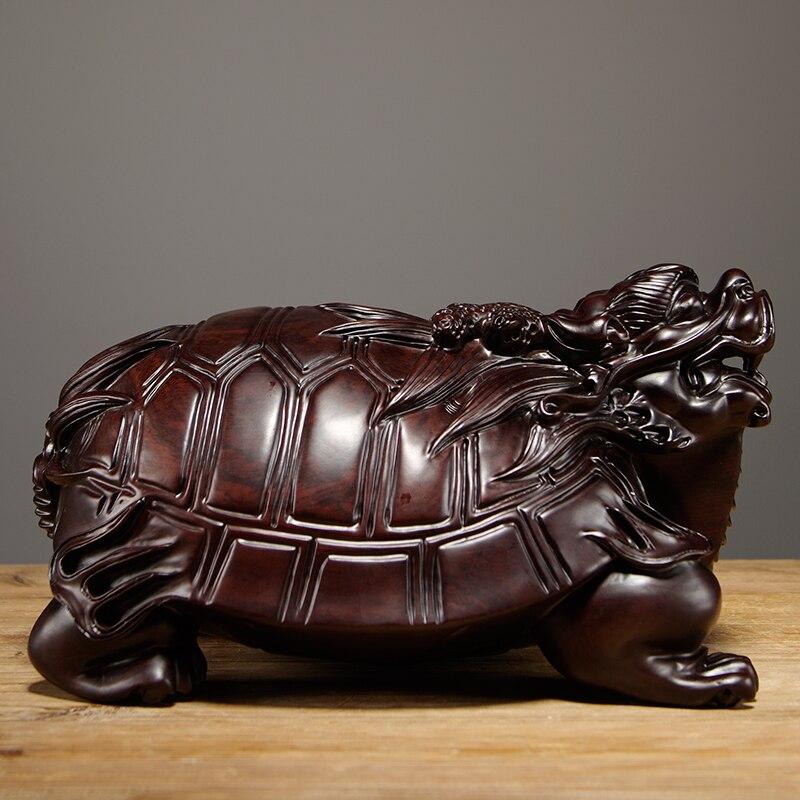 Bois de santal noir sculpté dragon tortue pendule pièce en bois véritable Rui animal salon meuble TV décoré avec de l'artisanat en bois rouge