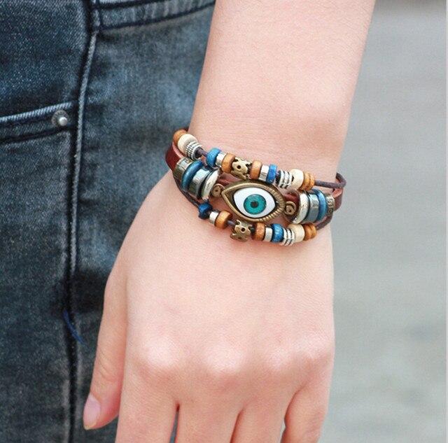 75418db112a8 Pulsera de cuero de múltiples capas Vintage hecha a mano ojo turco cuero  ajustable pulsera brazaletes