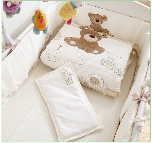 Discount! 7PCS Embroidered baby cot bedding sets cartoon little bear baby bedding sets ,include(bumper+duvet+sheet+pillow) 6pcs water spray swim dolphin babies toy