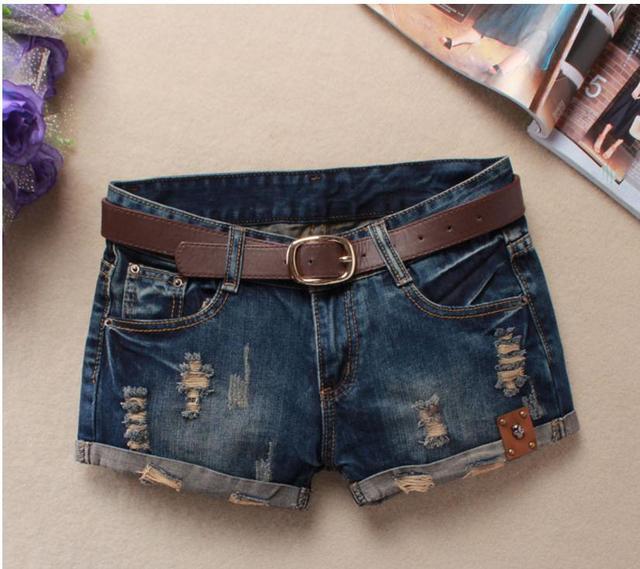 Letnie spodenki jeansowe dla kobiet Sexy mini szorty damskie nit otwory dżinsy krótkie spodenki w pasie bez paska zgrywanie Denim krótkie J2305