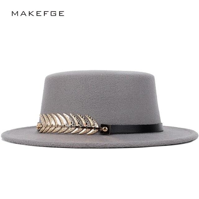 aca4f766447 Autumn and winter solid color feathers fedora men s hats flat top hat  classic retro caps men s