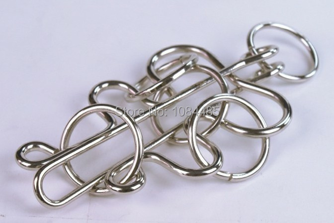 Metal Wire Puzzle Solutions : Wire puzzle rings center