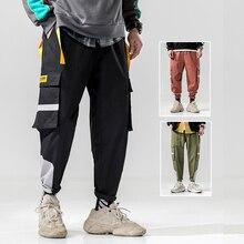 EPacket envío gratuito de moda joven hombres sueltos pantalones lápiz Hip  Hop Streetwear negro verde rojo 37998e0ced6