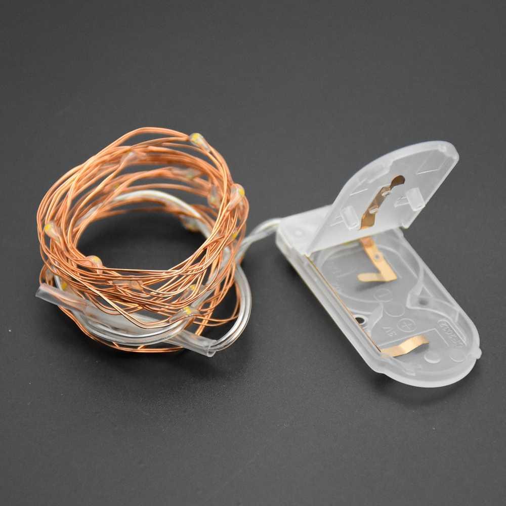 ไฟ LED ทองแดง Fairy 1M 2M LED CR2032 ปุ่มแบตเตอรี่ดำเนินการ Garland LED String Light Xmas งานแต่งงานตกแต่ง