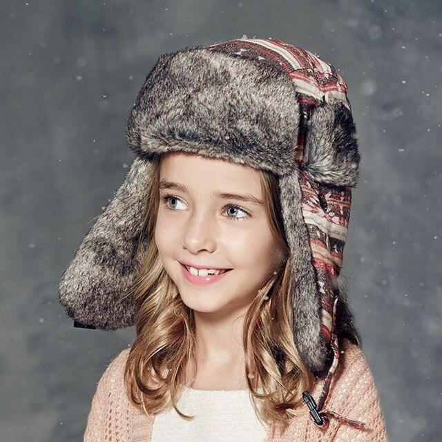 648aa353 Kenmont brand Winter Kids Girl Children Warm Outdoor Russian Trapper  Aviator Bomber Hats Ski Caps Ushanka Cold-proof 2336