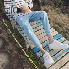 2017 summer new washing grinding white hole in nine points feet blue jeans men's trousers joker show thin big yards bag mail