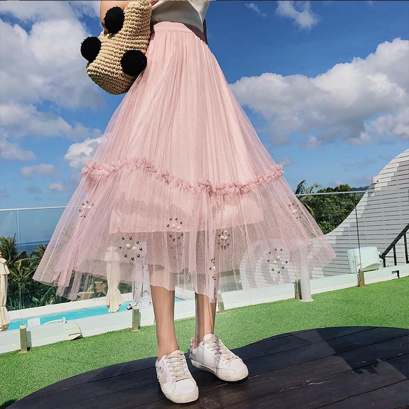2018 frauen Sommer Lange Tüll Rock Koreanischen Stil Süße Perlen rand 3D Blume Trim Netz Tunika Reich Plissee Tutu Rock weibliche